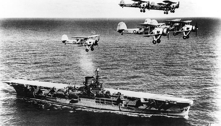 The Ark Royal, with a few of its little friends.